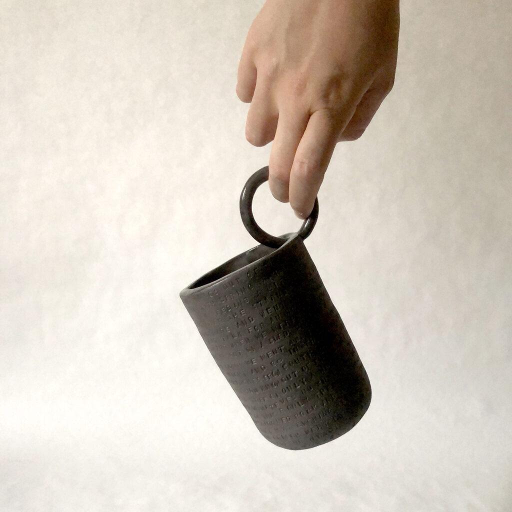 Spoken words - black vase