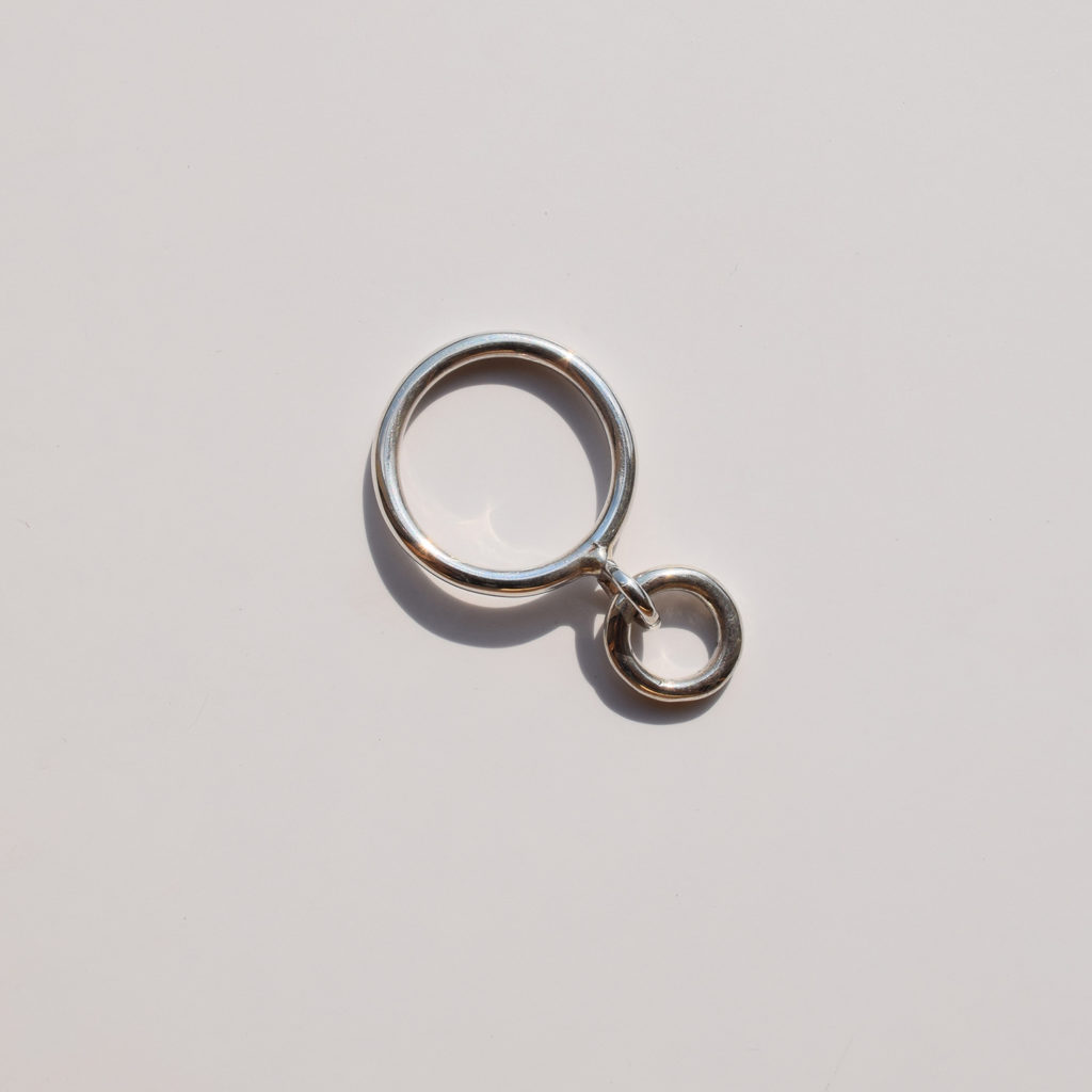 Bold ring with circle pendant